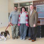 (L to R): Thor, Jeff Claudio's service dog; Jeff Claudio; Leonora Claudio; NWFSC President, Dr. Devin Stephenson.