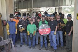 """Welding students hold """"Thank you"""" sign"""