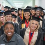 NWF State College students pose for a photo during commencement