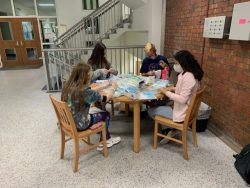 Northwest Florida State College Phi Theta Kappa students assemble safety kits for students at the beginning of the spring semester.